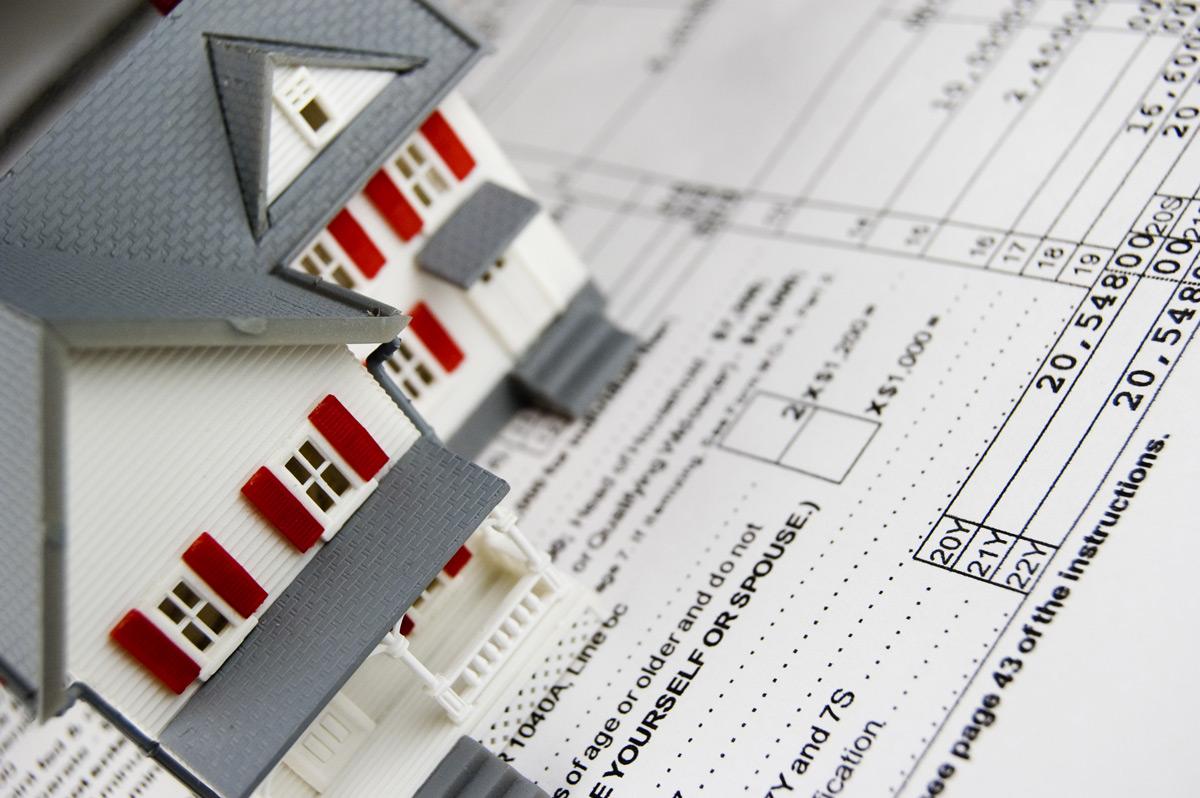По какой стоимости нужно рассчитывать налог на недвижимость: кадастровая, инвентаризационная или рыночная?